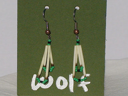 Two short quills and the two long quills all connected with Black and Green size thirteen cut glass beads. Ear attachment is French Hooks