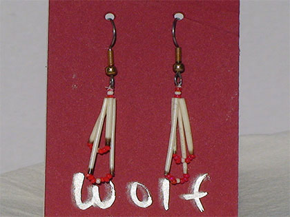 Two short quills and the two long quills all connected with White and Red size thirteen cut glass beads. Ear attachment is French Hooks