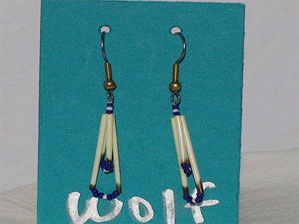 Two short quills and the two long quills all connected with Egg Shell and Navy blue size thirteen cut glass beads. Ear attachment is French Hooks