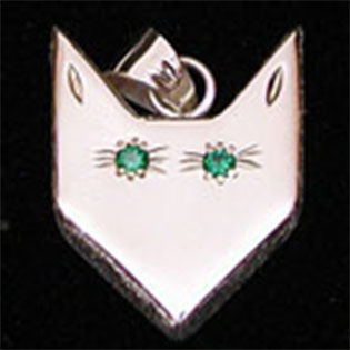 Wolf Waker Logo pendant with faceted green stone eyes set into sterling silver with texture sides that resembles fur