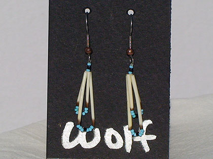 Two short quills and the two long quills all connected with Turquoise and Navy blue size thirteen cut glass beads. Ear attachment is French Hooks